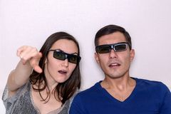 Young couple watching movie in 3D glasses, closeup portrait. stock images