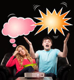 Young couple watching movie or sport broadcast on tv. Man being really expressive about the football match while his wife finds it boring. Comics concept Stock Photography
