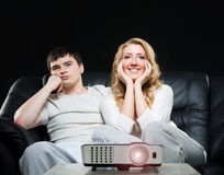 Young couple watching a movie Royalty Free Stock Images
