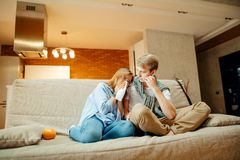 Couple watching sad movie, woman cry. Young couple watching sad movie, women cry Royalty Free Stock Photos