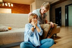 Couple watching sad movie, woman cry. Young couple watching sad movie, women cry Royalty Free Stock Photography