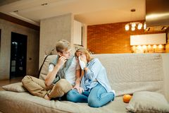 Couple watching sad movie, woman cry. Young couple watching sad movie, women cry Royalty Free Stock Photo
