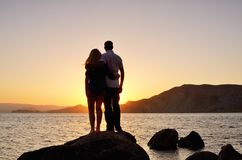 Young couple watching the sun Stock Photography