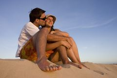Young couple watching a sunset Stock Images