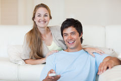 Young couple watching television Royalty Free Stock Photo
