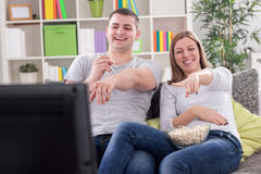 Young couple watching television Stock Images