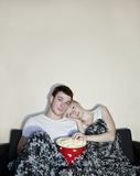 Young couple watching television Stock Image