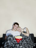 Young couple watching television Stock Photos