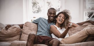 Young couple relaxing on the sofa royalty free stock images