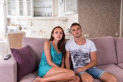 Young Couple Watching Television Together at Home Royalty Free Stock Photos