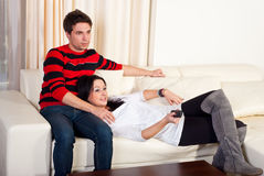 Young couple watching tv Stock Photo