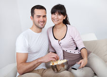 Young couple watching TV Stock Photography