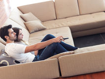 Young couple watching tv at home Stock Photos