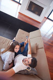 Young couple watching tv at home Royalty Free Stock Image
