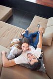 Young couple watching tv at home Stock Photography