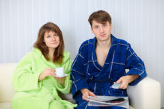 Young couple watching TV on sofa Royalty Free Stock Photo
