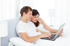 Young couple watching videos on their computer Royalty Free Stock Image
