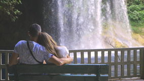 Young couple watching the waterfalls stock footage