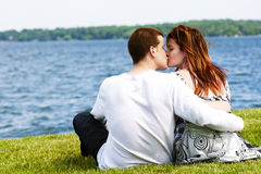 Young Couple by the water Stock Photo