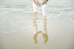 Young couple  in water on beach Stock Photos