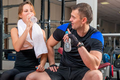 Young couple with water after a workout Royalty Free Stock Photo