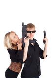 Young couple with the weapon Royalty Free Stock Photos