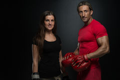 Young Couple Wearing Boxing Gloves And Smiling Stock Photography