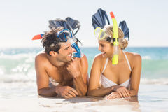 Young couple wearing diving mask lying on beach Stock Photography