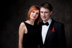 Young couple wearing evening garments Stock Images