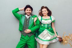 Young couple in festive costumes saint patrick`s day top view looking camera cheerful. Young couple wearing festive costumes saint patrick`s day top view  on Royalty Free Stock Photography