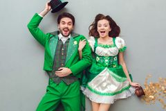 Young couple in festive costumes saint patrick`s day top view looking camera surprised. Young couple wearing festive costumes saint patrick`s day top view  on Royalty Free Stock Photos
