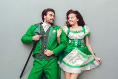 Young couple in festive costumes saint patrick`s day top view looking at each other in love. Young couple wearing festive costumes saint patrick`s day top view Stock Image