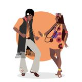 Young couple wearing hippie clothes of the 60s and 70s dancing.  Stock Images