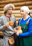 Young couple wearing medieval period costumes. Khabarovsk, Russia - June 11, 2017: Man and woman in middle ages peasant clothing at historic reenactment stock photo