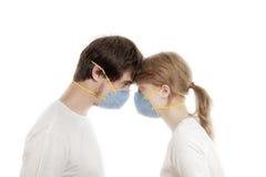 Young couple wearing respirators stock photo