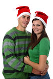 Young couple wearing Santa hats isolated on white Stock Images