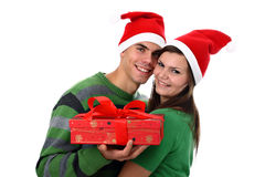 Young couple wearing Santa hats isolated on white stock photography