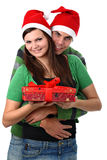 Young couple wearing Santa hats isolated on white Royalty Free Stock Photography