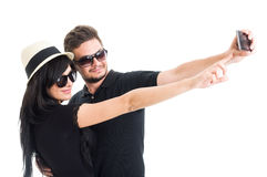 Young couple wearing shades and taking a selfie Royalty Free Stock Photo