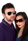 Young couple wearing  sunglasses. Young couple wearing sunglasses on white Royalty Free Stock Images