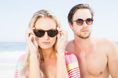 Young couple wearing sunglasses at beach Stock Photo