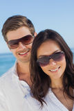Young couple wearing sunglasses and smiling at camera Royalty Free Stock Photo