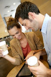 Young couple websurfing in coffee shop Stock Image