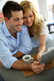 Young couple websurfing on internet Stock Image