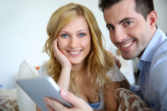 Young couple websurfing on internet stock photo