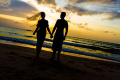 Young couple on wedding day on tropical beach and sunset Royalty Free Stock Photos