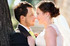 Young couple after wedding in a hug face to face Stock Photos