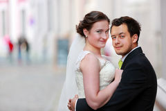 Young couple after wedding in hug and space for text royalty free stock photography