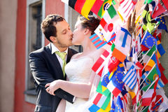 Young couple after wedding kissing in a hug stock images