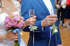 Young couple at a wedding reception with champagne glasses Royalty Free Stock Images